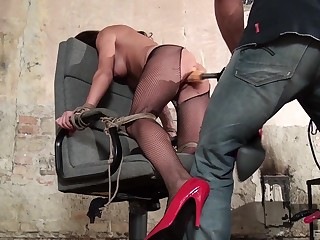 Busty woman fucked with huge toys in naughty BDSM maledom XXX