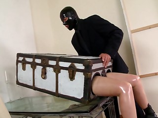 Lucy Latex gets her mouth fucked balls deep wits her male comrade-in-arms