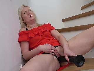 Horny mature chick in heels enjoys inserting a massive toy in her cunt